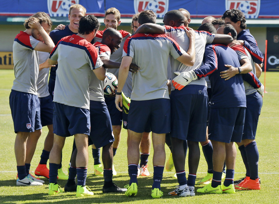 Photo - U.S. men's soccer team members embrace during training in preparation for the World Cup, Wednesday, May 21, 2014, in Stanford, Calif. (AP Photo/Marcio Jose Sanchez)