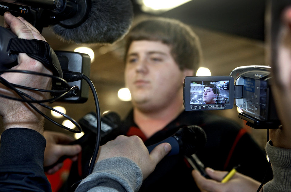 Mustang High School's Bronson Irwin is talks to the media after signing to play football for the University of Oklahoma (OU) at Mustang High School on Wednesday, Feb. 3, 2010, in Mustang, Okla.   Photo by Chris Landsberger, The Oklahoman