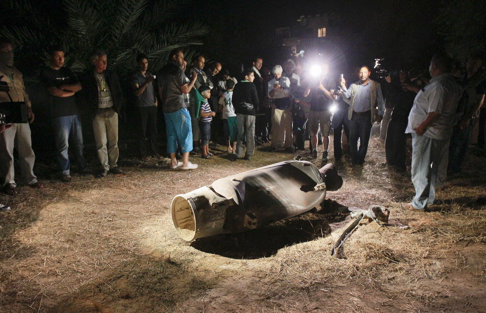 Photo -   In this photo taken on a government organized tour in the early hours of Monday, June 6, 2011, reporters are taken to observe a device at a farm house on the outskirts of Tripoli, Libya. Officials first claimed that a NATO strike had targeted the farm house, however when questioned as to what appeared to be Cyrillic script on the device, one official then said the NATO strike had hit a missile depot about a kilometer away and one of those missiles had landed on the farm. (AP Photo/Ivan Sekretarev)