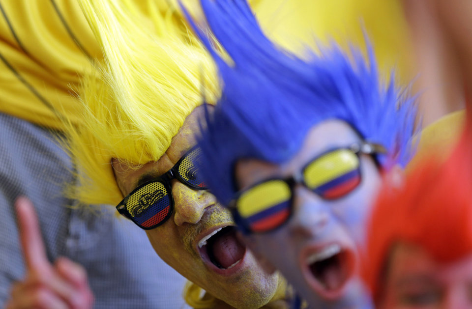 Photo - Colombia's fans cheer prior to  the group C World Cup soccer match between Colombia and Ivory Coast at the Estadio Nacional in Brasilia, Brazil, Thursday, June 19, 2014.  (AP Photo/Themba Hadebe)