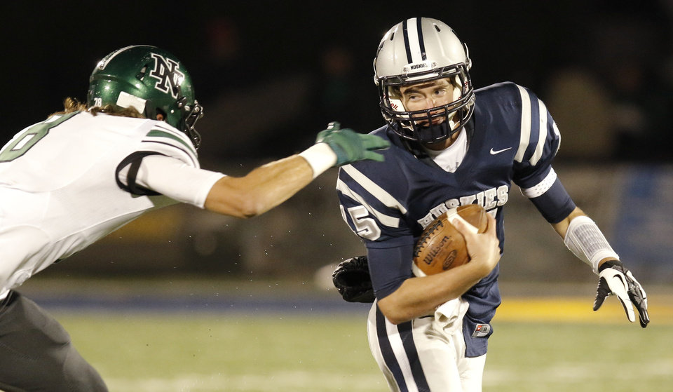 NN#8 Cale Horton catches EN#15Stephen McClernon on a sweep during the high school football game between Norman North and Edmond North in Edmond at Wantland Stadium Friday, Friday, October 18, 2013.  Photo by Doug Hoke, The Oklahoman