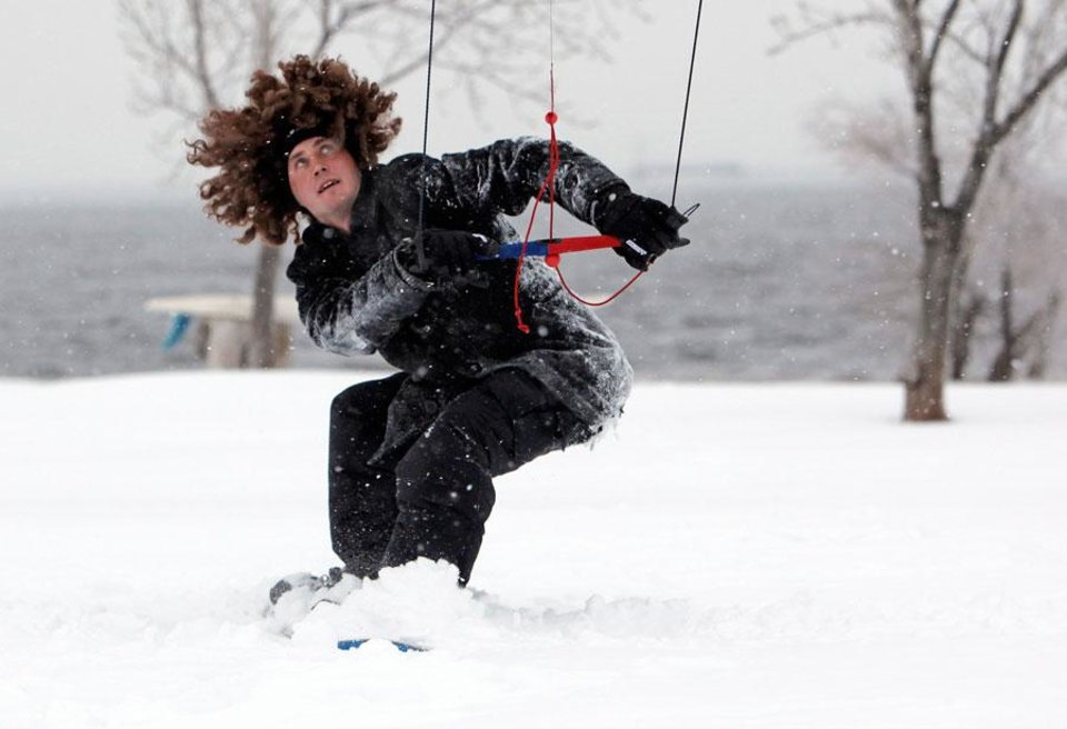 Photo -   WINTER STORM / SNOW STORM: Chris Roberts is pulled by a power kite on a snowboard at Lake Hefner during a winter storm in Oklahoma City, Friday, January 29, 2010. Photo by Nate Billings, The Oklahoman