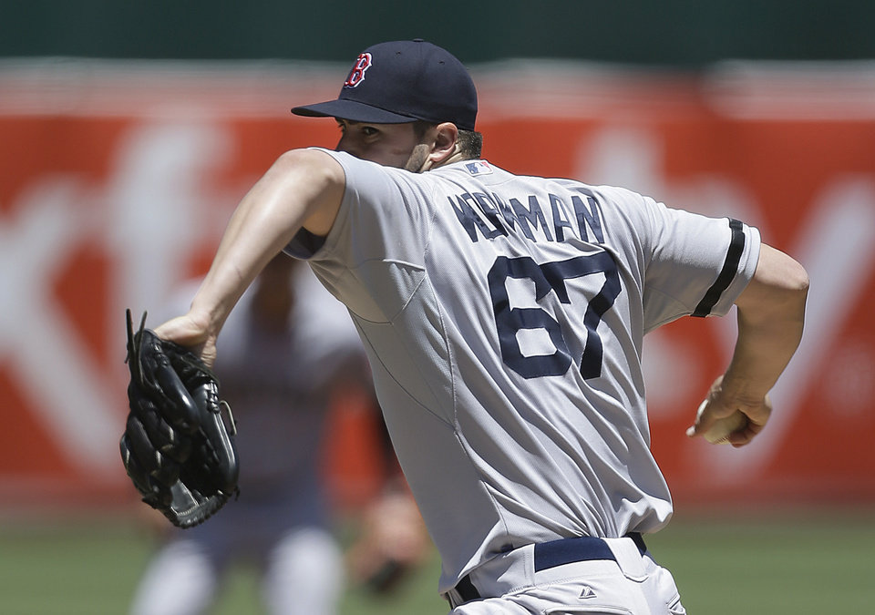 Photo - Boston Red Sox's Brandon Workman pitches against the Oakland Athletics in the first inning of a baseball game Sunday, July 14, 2013, in Oakland, Calif. (AP Photo/Ben Margot)
