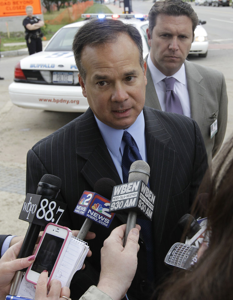 Photo -   Buffalo Police spokesperson Michael DeGeorge speaks to the media at the scene of a shooting at Erie Count Medical Center in Buffalo, N.Y., Wednesday, June 13, 2012. (AP Photo/David Duprey)