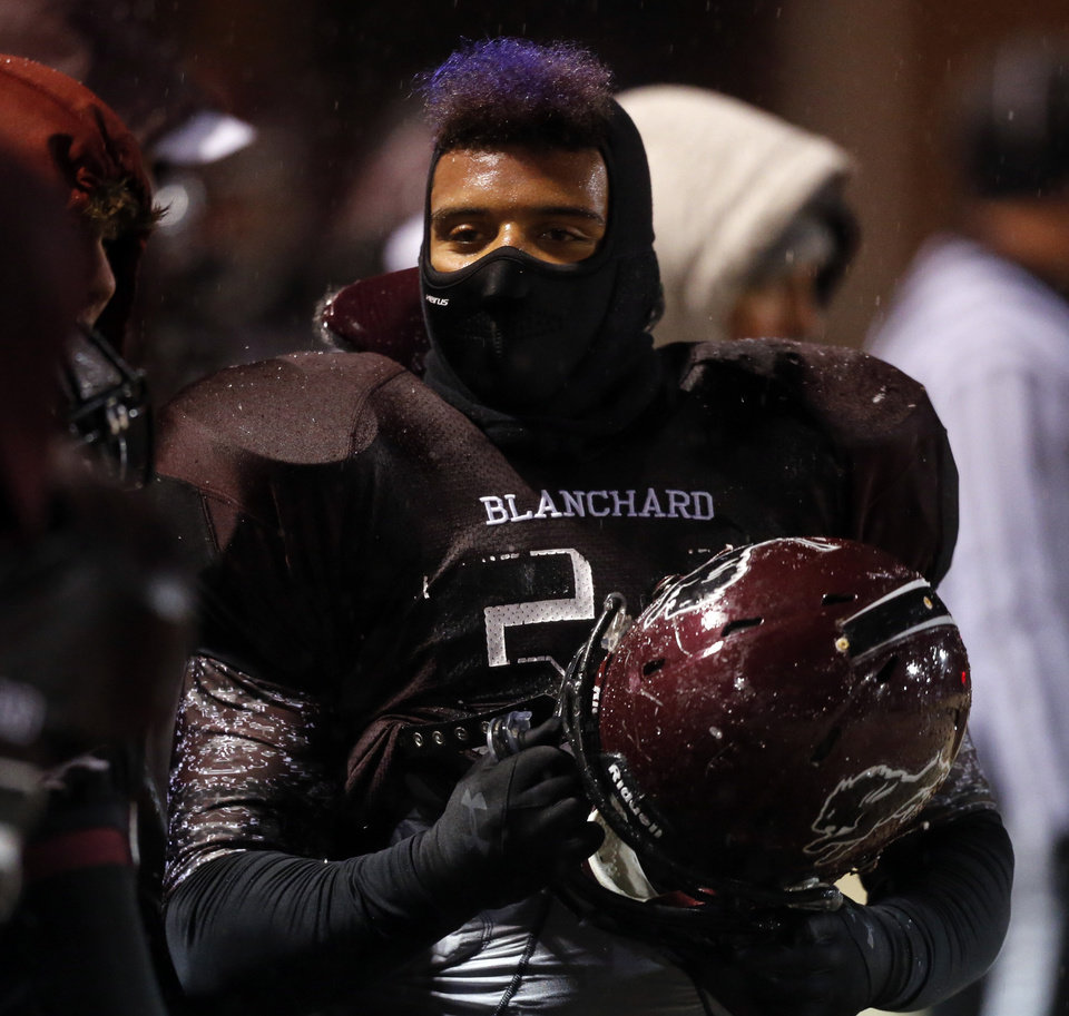 Photo - Blanchard's DJ Williams is dressed for the cold as Newcastle plays Blanchard in Class 3A high school football playoffs on Friday, Nov. 22, 2013, in Blanchard, Okla. Photo by Steve Sisney, The Oklahoman
