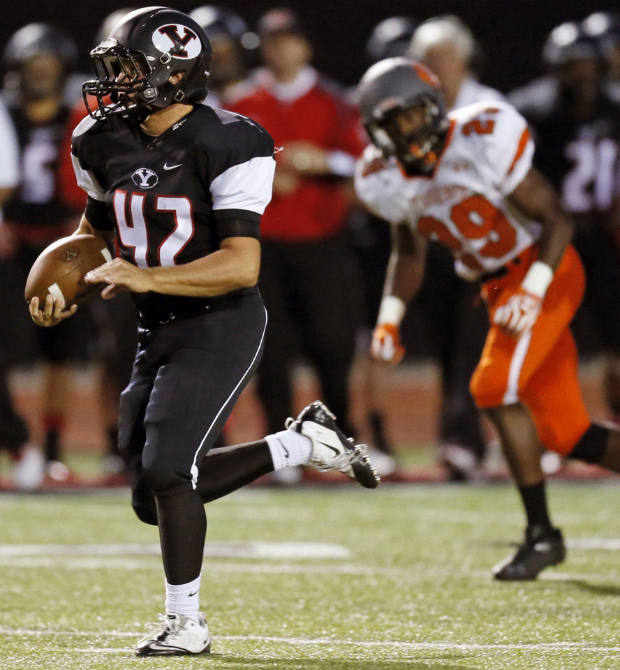 Photo - Yukon's Caleb Davis (42) takes the ball 66 yards for a touchdown during a high school football game between Norman and Yukon at Yukon High School in Yukon, Okla., Friday, Sept. 20, 2013. Photo by Nate Billings, The Oklahoman