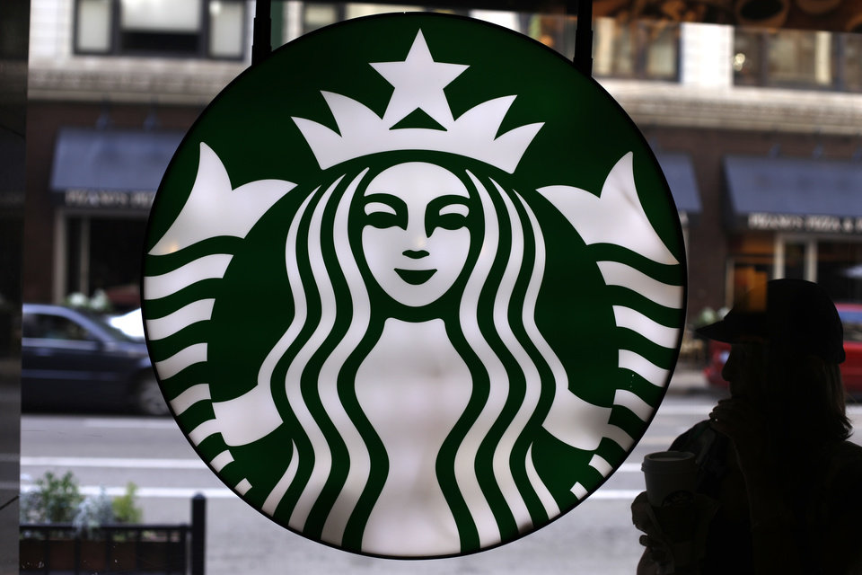 Photo -  In this May 31 photo, the Starbucks logo is seen at one of the company's coffee shops in downtown Chicago. Starbucks is announcing a new program to help its baristas earn an online degree. The company is partnering with Arizona State University to make the program available to 135,000 U.S. employees who work at least 20 hours a week. They will be able to choose from a number of educational programs. AP Photo   Gene J. Puskar -  AP