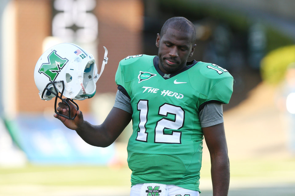 Photo - FILE - In this Oct. 6, 2012, file photo, Marshall quarterback Rakeem Cato reacts after a Herd fumble was recovered and turned into a touchdown by Tulsa during an NCAA college football game in Huntington, W.Va. Cato faced multiple challenges growing up. His mother died in 2005 when he was 13 and his father had been in prison since before he was born. (AP Photo/The Herald-Dispatch, Mark Webb, File)