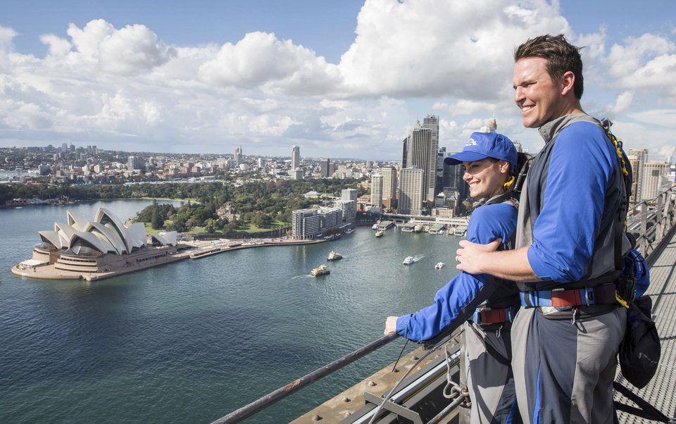 Photo - In this photo released by Destination NSW, Arizona Diamondbacks' pitcher Will Harris with his wife enjoys viewing from the Sydney Harbour Bridge in Sydney, Thursday, March 20, 2014. The Diamondbacks will play the Los Angeles Dodgers in their Major League Baseball season opening games at the Sydney Cricket Ground on Saturday and Sunday. (AP Photo/Destination NSW, James Horan)