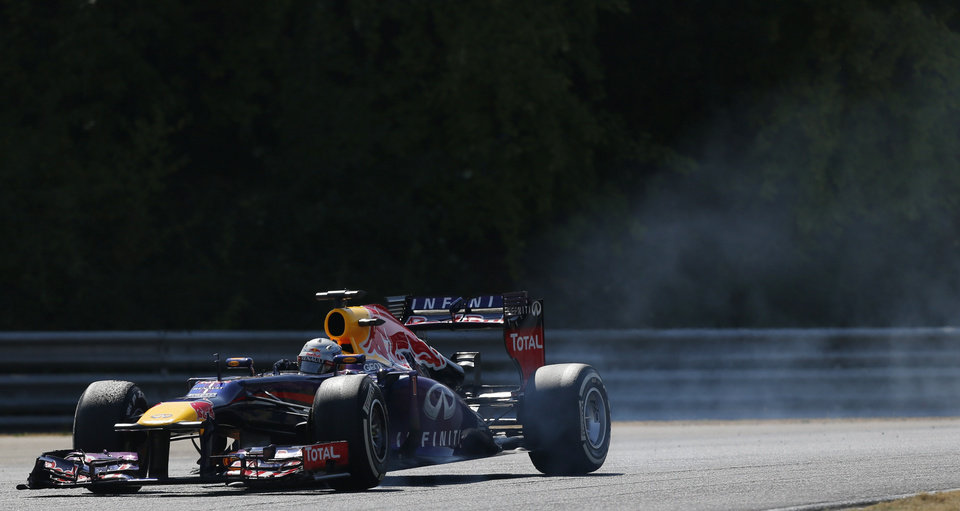 Photo - Red Bull driver Sebastian Vettel of Germany steers his car during the Hungarian Formula One race at the Hungaroring racetrack near Budapest, Hungary, Sunday, July 28, 2013. (AP Photo/Petr David Josek)