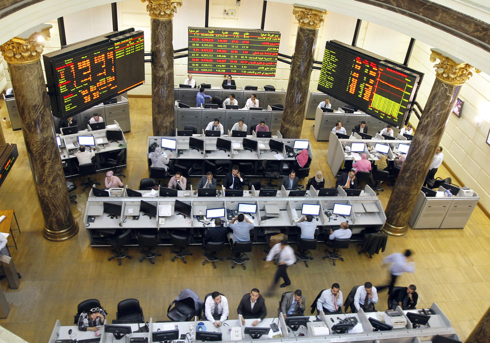 Photo -   FILE - In this Wednesday, Oct. 29, 2008 file photo, Egyptian brokers work during a session at the Egyptian stock market in Cairo, Egypt. Egypt's benchmark stock index on Sunday plunged by more than 9.5 percent in the first trading session since the country's Islamist president issued decrees to assume sweeping new powers, while police in central Cairo fired tear gas at protesters who accuse the Egyptian leader of a blatant power grab. (AP Photo/Amr Nabil, File)