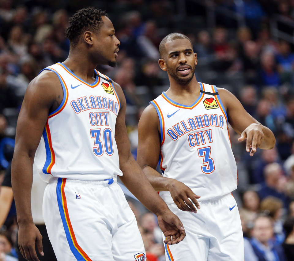 Photo - Oklahoma City's Chris Paul (3) talks to Deonte Burton (30) as they walk off the court for timeout in the second quarter during an NBA basketball between the Oklahoma City Thunder and the Toronto Raptors at Chesapeake Energy Arena in Oklahoma City, Wednesday, Jan. 15, 2020. [Nate Billings/The Oklahoman]