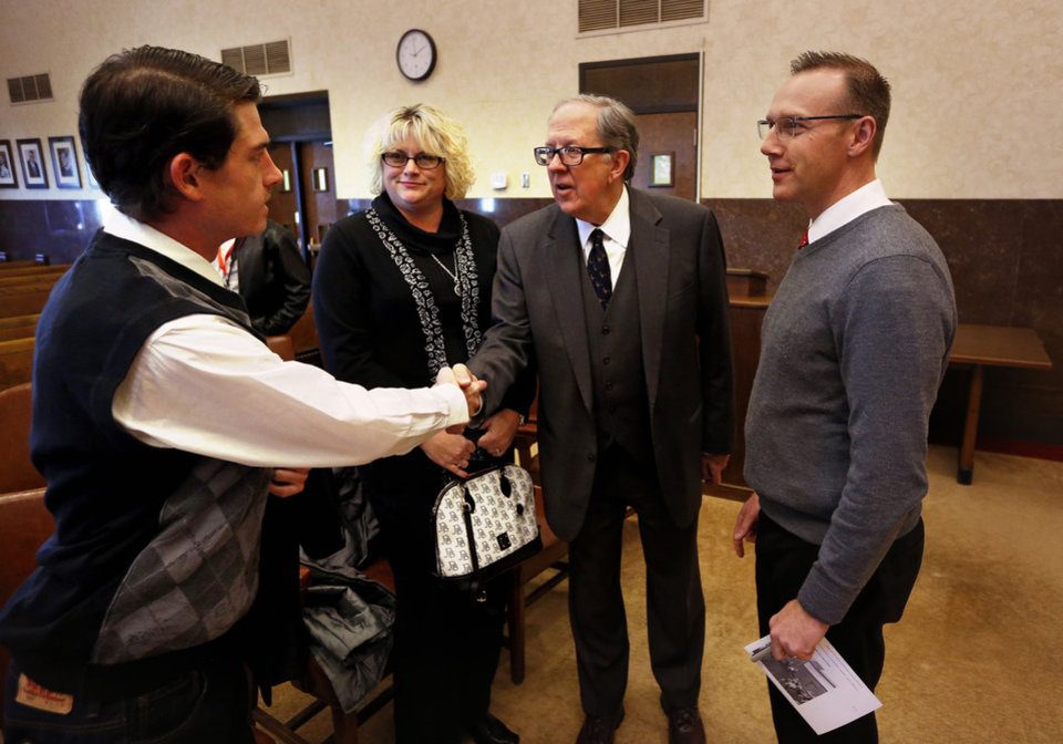 Photo -  Oklahoma Bar Association President Garvin Isaacs, second from right, speaks with former jurors Joe Hurley and Rhonda Bontempi as he presents appreciation awards to Norman judges and jurors. District Judge Thad Balkman is at right. [PHOTO BY STEVE SISNEY, THE OKLAHOMAN]