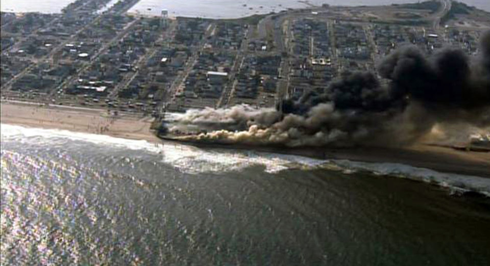 Photo - CORRECTS LOCATION TO SEASIDE HEIGHTS INSTEAD OF SEASIDE PARK - This frame grab from video provided by Fox 29 shows a raging fire in Seaside Heights, N.J. on Thursday, Sept. 12, 2013.  The fire apparently started in an ice cream shop and spread several blocks down  the New Jersey shore boardwalk that was damaged in Superstorm Sandy (AP Photo/Fox 29) MANDATORY CREDIT