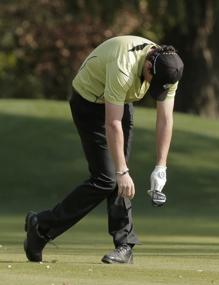 Photo -   Europe's Rory McIlroy reacts after hitting a shot on the 10th hole during a four-ball match at the Ryder Cup PGA golf tournament Friday, Sept. 28, 2012, at the Medinah Country Club in Medinah, Ill. (AP Photo/Charlie Riedel)