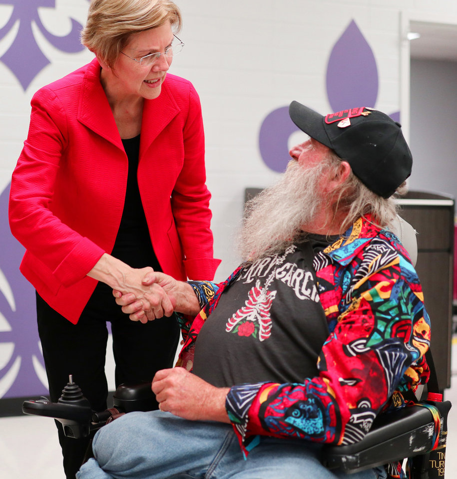 Photo - U.S. Senator and NWC Alum, Class of '66 Elizabeth Warren, poses with Wes Ginder after the AFT education rally at Northwest Classen High School, Saturday, September, 22, 2018.  Photo by Doug Hoke, The Oklahoman