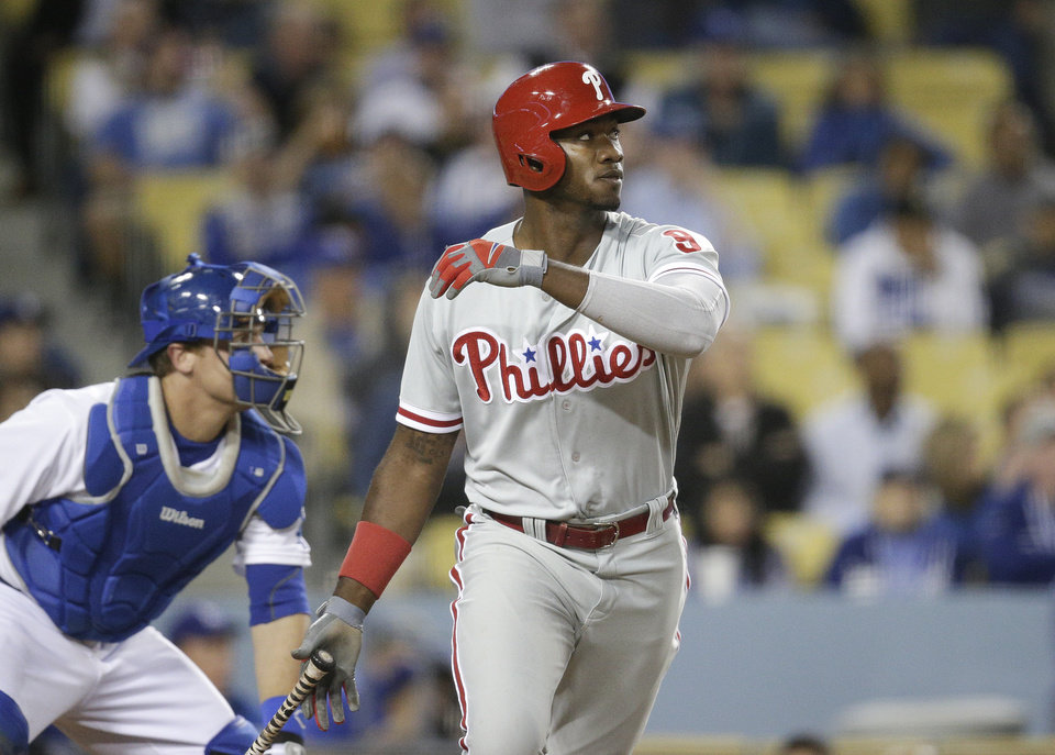 Photo - Philadelphia Phillies' Domonic Brown watches his RBI double during the 10th inning of a baseball game against the Los Angeles Dodgers on Tuesday, April 22, 2014, in Los Angeles. (AP Photo/Jae C. Hong)