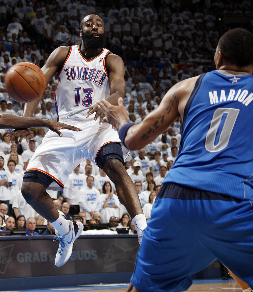 Oklahoma City\'s James Harden (13) passes the ball away from Dallas\' Shawn Marion during Game 2 of the first round in the NBA basketball playoffs between the Oklahoma City Thunder and the Dallas Mavericks at Chesapeake Energy Arena in Oklahoma City, Monday, April 30, 2012. Oklahoma City won, 102-99. Photo by Nate Billings, The Oklahoman