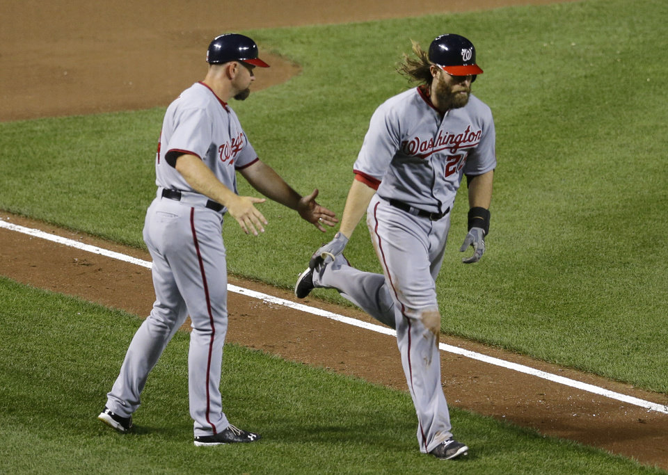 Photo - Washington Nationals' Jayson Werth, right,  jogs past third base coach Bob Henley after hitting a solo home run in the seventh inning of an interleague baseball game against the Baltimore Orioles, Wednesday, July 9, 2014, in Baltimore. (AP Photo/Patrick Semansky)