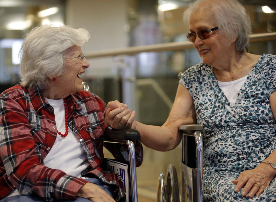 Photo - Sadie Fanali and Lorraine Thomas talk after meeting for the first time at Will Roger World Airport, Friday, June 14, 2013, in Oklahoma City.  The pair have been pen pals since 1932. Photo by Sarah Phipps, The Oklahoman
