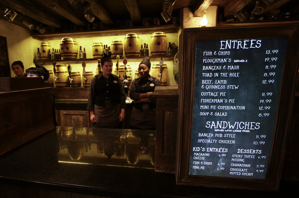 Photo - The menu of items at the Leaky Cauldron restaurant is seen during a preview of Diagon Alley at the Wizarding World of Harry Potter at Universal Orlando, Thursday, June 19, 2014, in Orlando, Fla. (AP Photo/John Raoux)