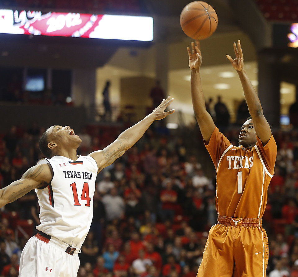 Photo - Texas' Isaiah Taylor shoots over Texas Tech's Robert Turner during their NCAA college basketball game in Lubbock, Texas, Saturday, Mar, 8, 2014. (AP Photo/Lubbock Avalanche-Journal, Zach Long) ALL LOCAL TV OUT