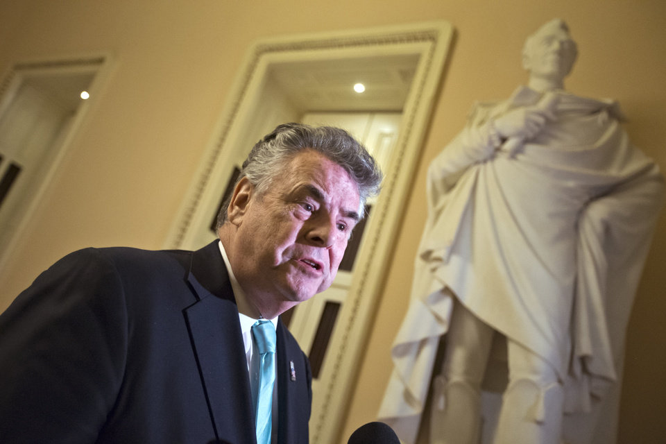 Photo - Rep. Peter King, R-N.Y., speaks to reporters after appearing before the House Rules Committee to work on an aid package to assist victims of Superstorm Sandy on Monday, Jan. 14, 2013, at the Capitol in Washington. The House is expected to vote on the bill Tuesday. (AP Photo/J. Scott Applewhite)