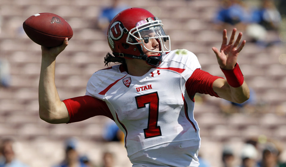Utah quarterback Travis Wilson (7) throws downfield against UCLA during the second half of their NCAA college football game, Saturday, Oct. 13, 2012, in Pasadena, Calif. UCLA won 21-14. (AP Photo/Alex Gallardo)