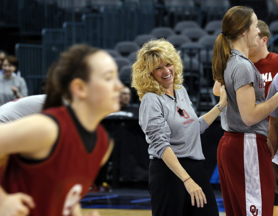 Photo - Oklahoma head coach Sherri Coale laughs at practice during the press conference and practice day at the Oklahoma City Regional for the NCAA women's college basketball tournament at Chesapeake Arena in Oklahoma City, Saturday, March 30, 2013. Photo by Sarah Phipps, The Oklahoman