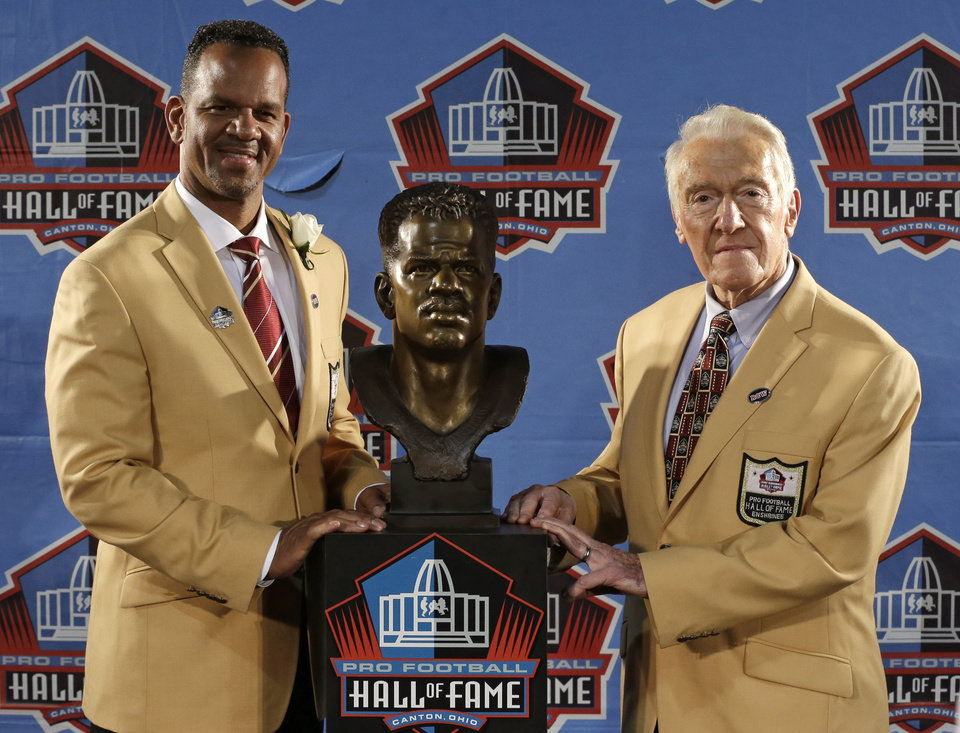 Photo - Hall of Fame inductee Andre Reed, left, and presenter Marv Levy pose with the bust during the 2014 Pro Football Hall of Fame Enshrinement Ceremony at the Pro Football Hall of Fame Saturday, Aug. 2, 2014, in Canton, Ohio. (AP Photo/Tony Dejak)