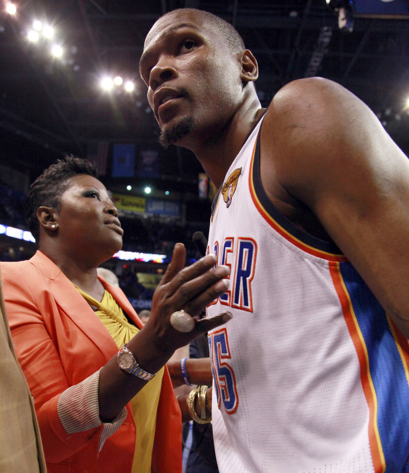 Oklahoma City Thunder small forward Kevin Durant (35) and his mother, Wanda Pratt meet on the floor after Game 1 of the NBA finals basketball series, Tuesday, June 12, 2012, in Oklahoma City. The Thunder won 105-94. (AP Photo/Jeff Roberson)
