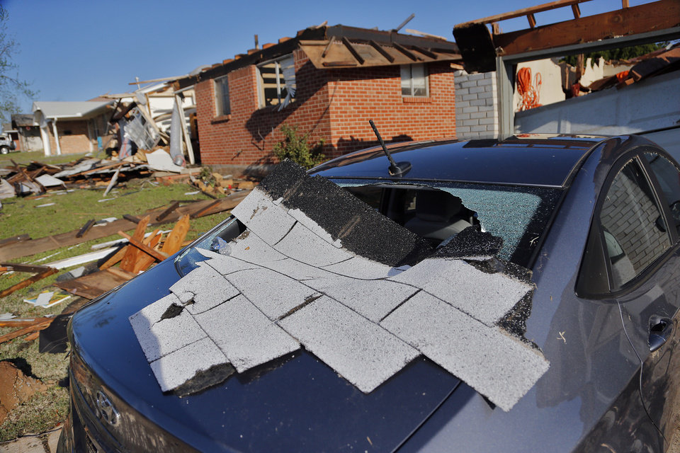 Photo - Storm damage to a home in Moore, Okla. on Thursday, March 26, 2015. A tornado hit the area on Wednesday evening causing damage in the area.  Photo by Chris Landsberger, The Oklahoman