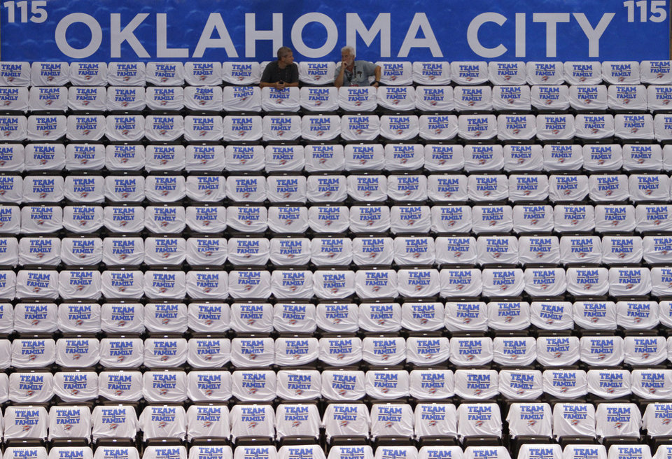 Photo - White Thunder shirts line the seats before the start of Game 2 of the NBA Finals between the Oklahoma City Thunder and the Miami Heat at Chesapeake Energy Arena in Oklahoma City, Thursday, June 14, 2012. Photo by Chris Landsberger, The Oklahoman