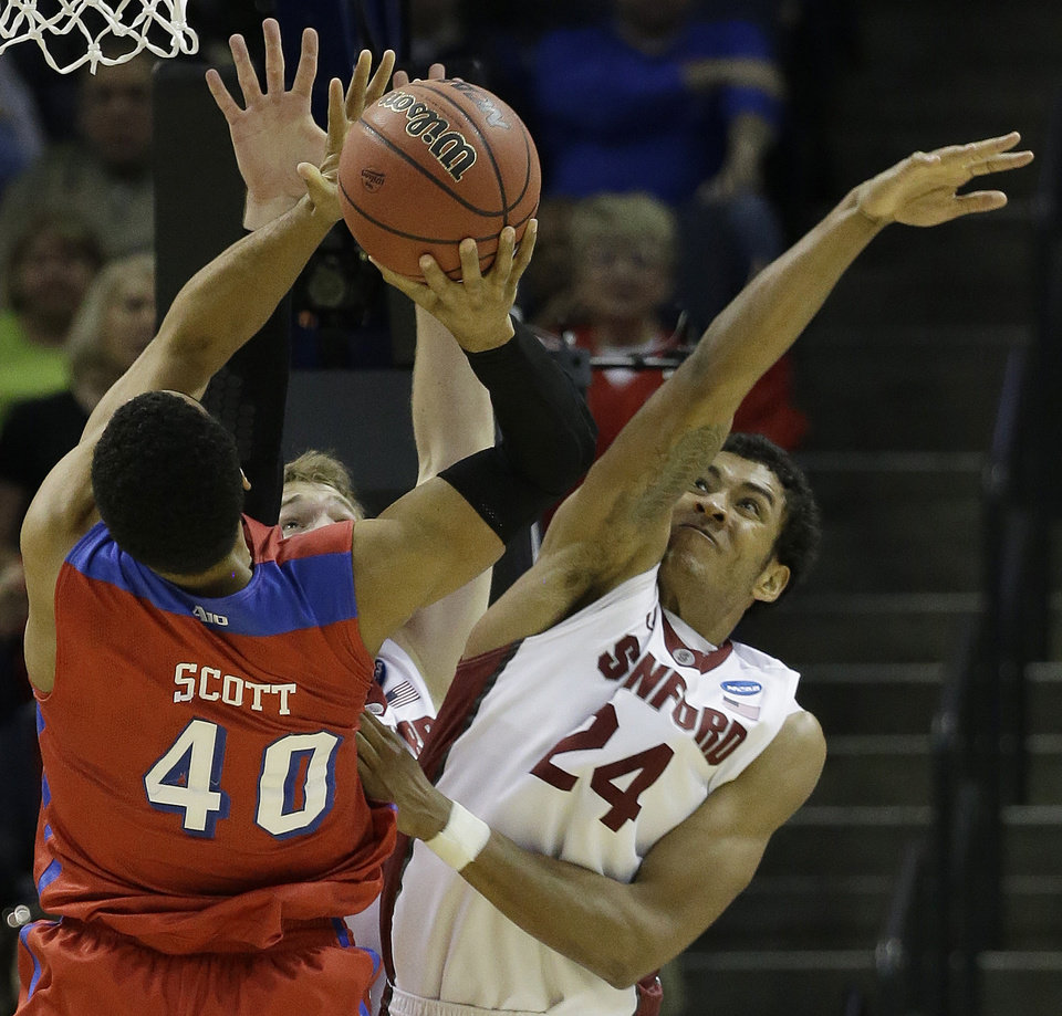 Photo - Dayton's Devon Scott (40) shoots against Stanford forward Josh Huestis (24) during the second half in a regional semifinal game at the NCAA college basketball tournament, Thursday, March 27, 2014, in Memphis, Tenn. (AP Photo/Mark Humphrey)
