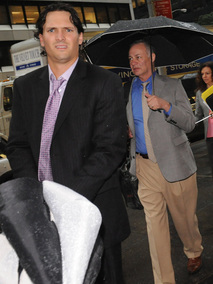 Photo -   Winnipeg Jets' Ron Hainsey, left, and Steve Fehr, players union special counsel, arrive at NHL headquarters in New York, Friday, Sept. 28, 2012. With the clock ticking down to the start of the season, the NHL and its locked-out players are talking again. (AP Photo/ Louis Lanzano)