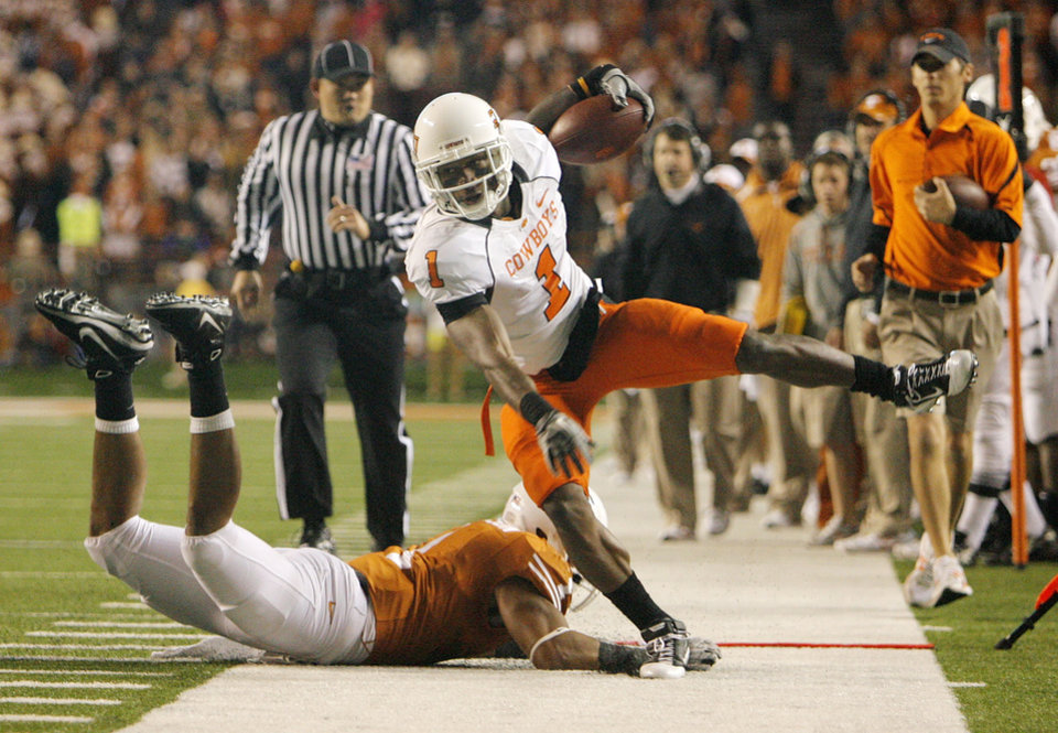 Photo - OSU's Joseph Randle (1) gets knocked out of bounds by Keenan Robinson (1) of Texas in the first quarter during the college football game between the Oklahoma State University Cowboys (OSU) and the University of Texas Longhorns (UT) at Darrell K Royal-Texas Memorial Stadium in Austin, Texas, Saturday, November 13, 2010. Photo by Nate Billings, The Oklahoman