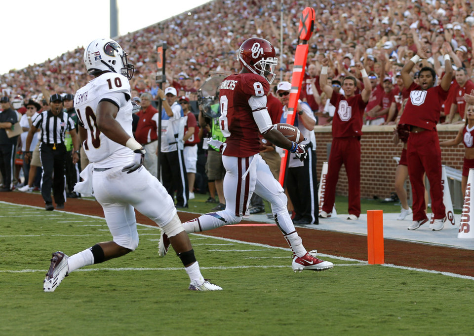 Photo - Oklahoma's Jalen Saunders (8) scores a touchdown beside Louisiana Monroe's Cordero Smith (10) during the NCAA college football game between the University of Oklahoma Sooners (OU) and the University of Louisiana Monroe Warhawks at Gaylord Family-Oklahoma Memorial Stadium in Norman, Okla., on Saturday, Aug. 31, 2013. Photo by Bryan Terry The Oklahoman