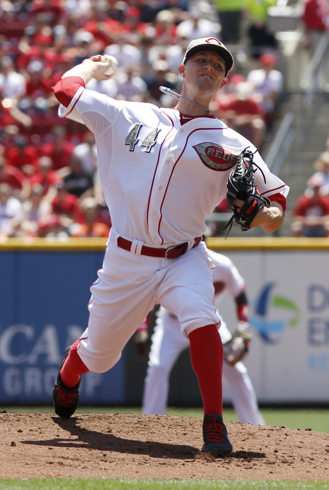 Photo - Cincinnati Reds starting pitcher Mike Leake throws against the Cleveland Indians in the first inning during a baseball game, Monday, May 27, 2013, in Cincinnati. (AP Photo/David Kohl)