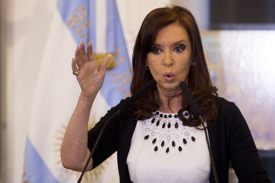 Photo - FILE - In this Feb. 12, 2014, file photo, Argentine President Cristina Fernandez gives a speech, aired on national TV, during an event at the Casa Rosada government palace in Buenos Aires, Argentina. President Fernandez said Monday June 16, 2014, that Argentina can't comply with U.S. court orders to pay $1.5 billion to winners of a decade-long legal battle over defaulted debt, the position her country was left in Monday when the U.S. Supreme Court refused to hear her government's final appeal. (AP Photo/Victor R. Caivano, File)