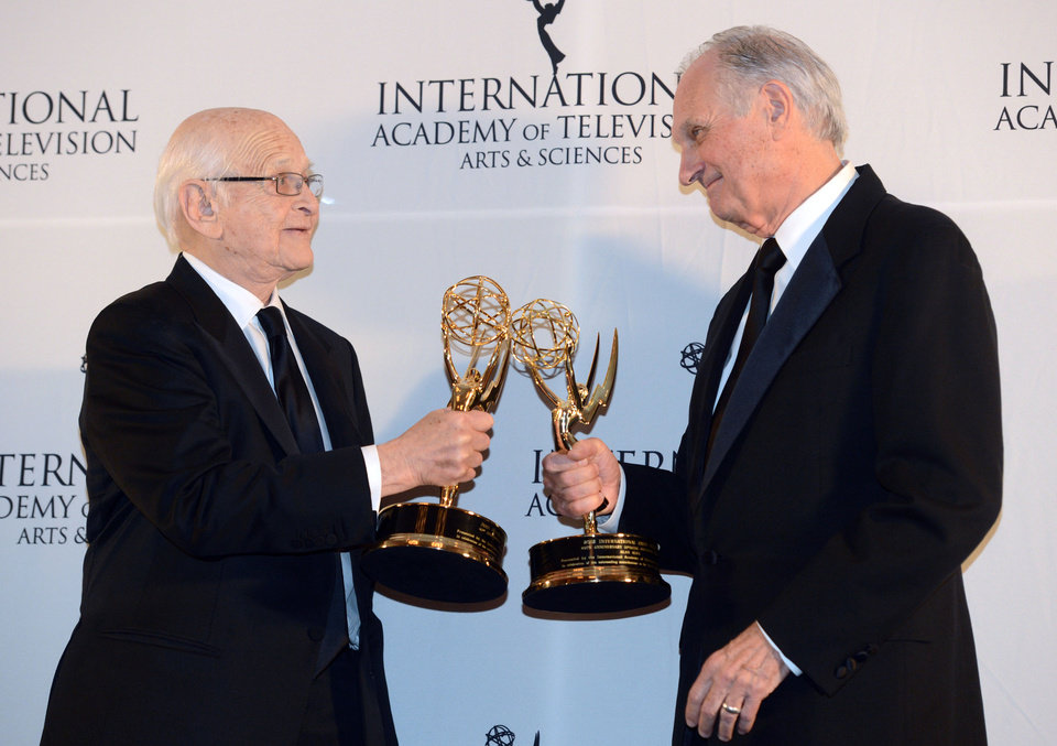 Photo -   Alan Alda, right, touches statues with Norman Lear after winning Special Founders Awards at the 40th International Emmy Awards, Monday, Nov. 19, 2012 in New York. (AP Photo/Henny Ray Abrams)