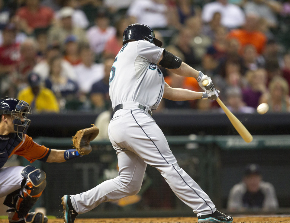 Seattle Mariners' Kyle Seager hits a two-run home run in the fourth inning against the Houston Astros during a baseball game Friday, July 19, 2013, in Houston. (AP Photo/Bob Levey)