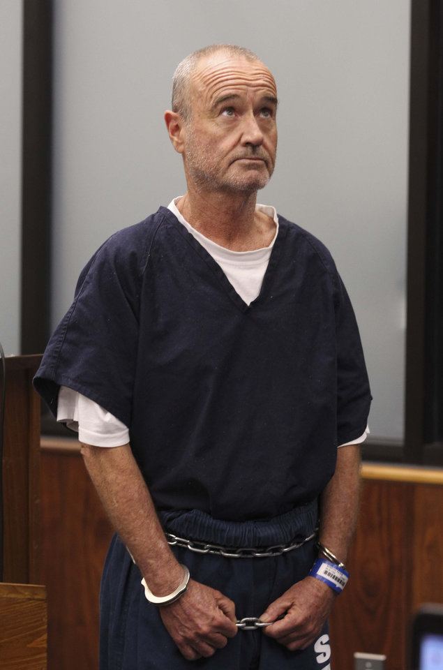 Photo - Peter Robbins appears for his arraignment Wednesday, Jan. 23, 2013 in San Diego, on charges of stalking and threatening his former girlfriend and a plastic surgeon who gave her a breast enhancement he apparently didn't like. Robbins who was the voice of Charlie Brown in several