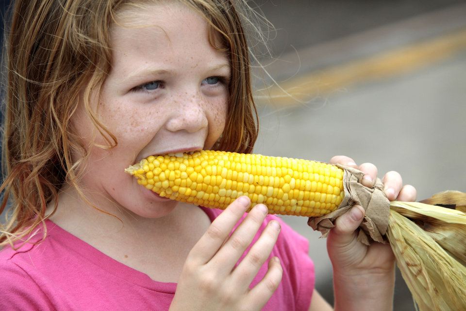 Photo - Cami Talley, 76, from Jones, eats a ear of corn, despot having a few teeth missing, at the Oklahoma State Fair , Friday, September 13, 2013.  Photo by David McDaniel, The Oklahoman