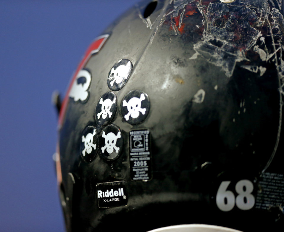 Photo - A Westmoore high school football player wears stickers on his helmet during a high school football game in Moore, Okla., Thursday, September 13, 2012. Photo by Bryan Terry, The Oklahoman