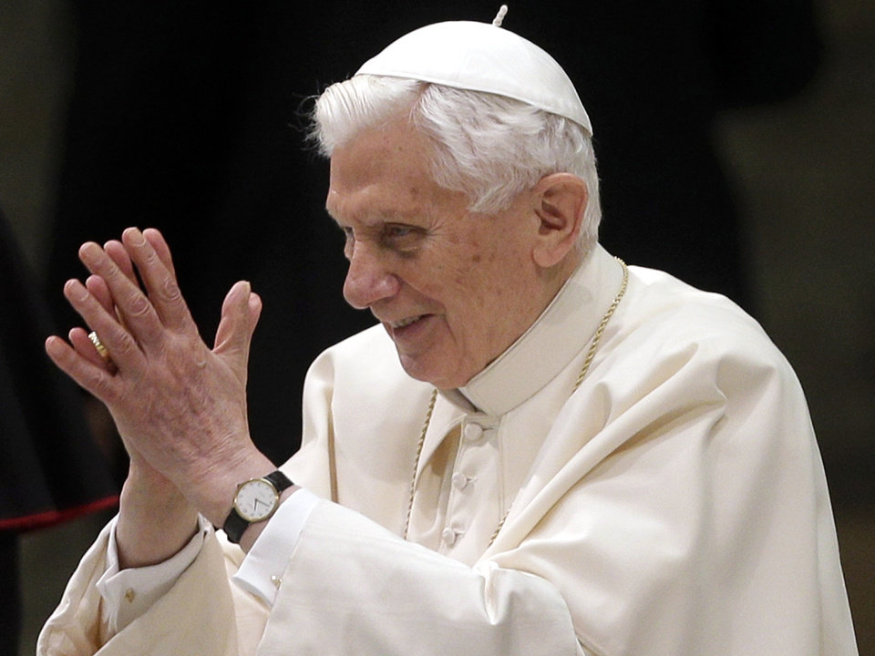 Photo - Pope Benedict XVI arrives for his weekly general audience at the Paul VI Hall at the Vatican, Wednesday Feb. 13, 2013. Pope Benedict XVI is telling the faithful in his first public appearance since announcing his resignation that he stepping down for