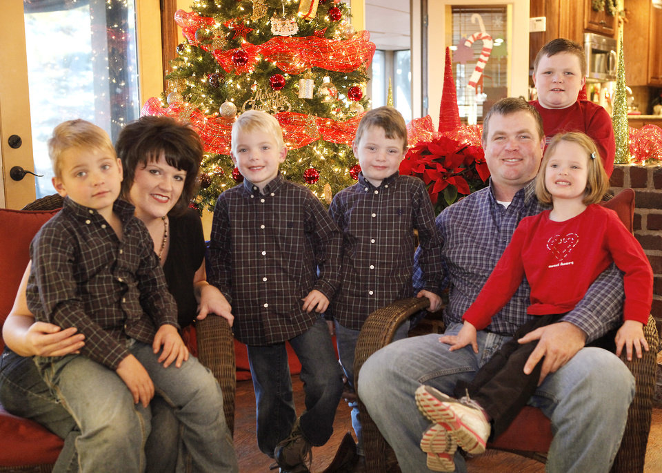 Photo - Rick and Jennifer Payne's quadruplets turned 5 this month. Shown from left are Preston, 5, Jennifer, Carson, 5, Griffin, 5, Rick, Parker, 8, and Claire, 5. Photo by David McDaniel, The Oklahoman