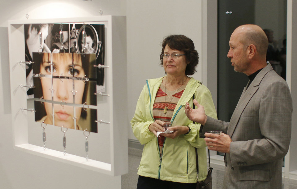 Photo - Jacqueline De Los Santos, one of Meyer's UCO professors, and Terry Bechtold discuss