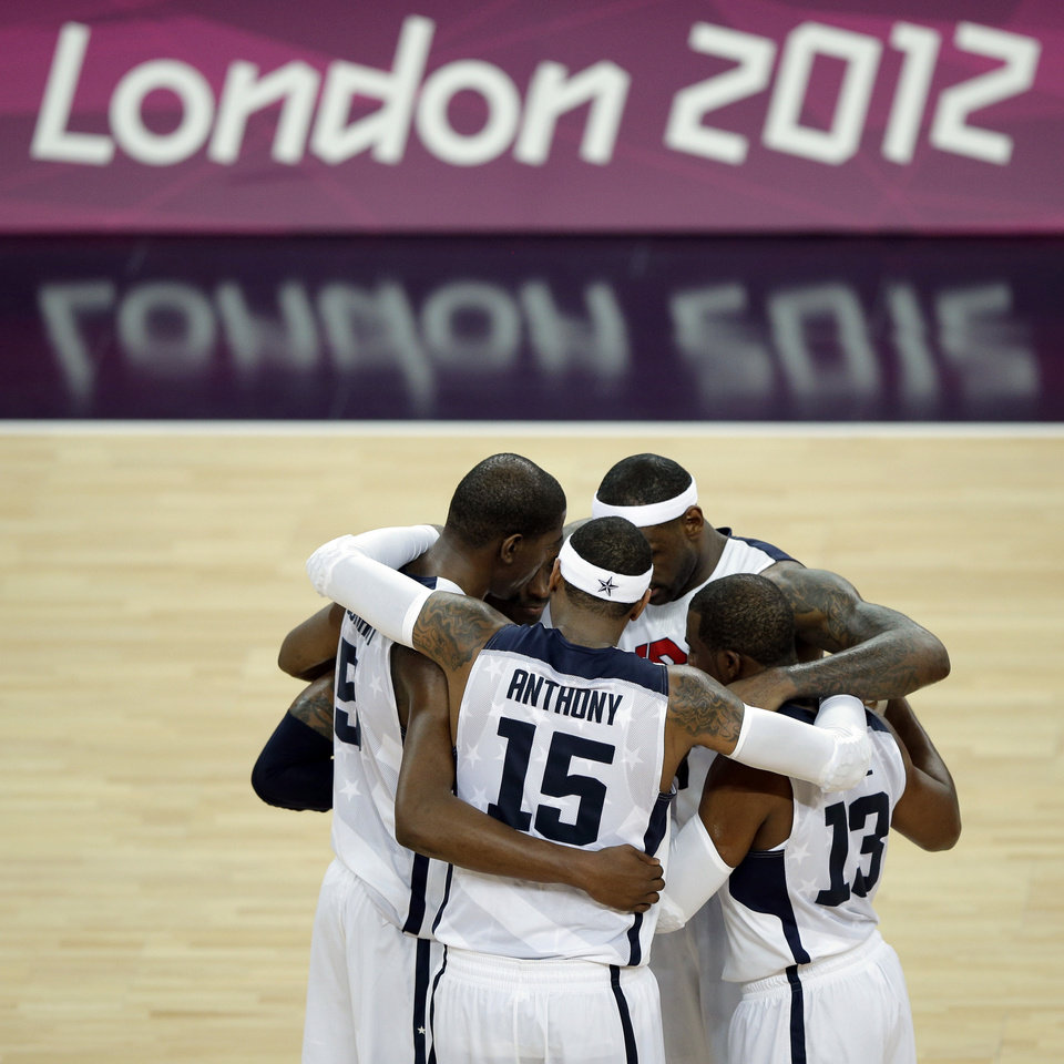 Members of the United States basketball team talk before the start of the fourth quarter during the men's gold medal basketball game against Spain at the 2012 Summer Olympics, Sunday, Aug. 12, 2012, in London. (AP Photo/Matt Slocum)