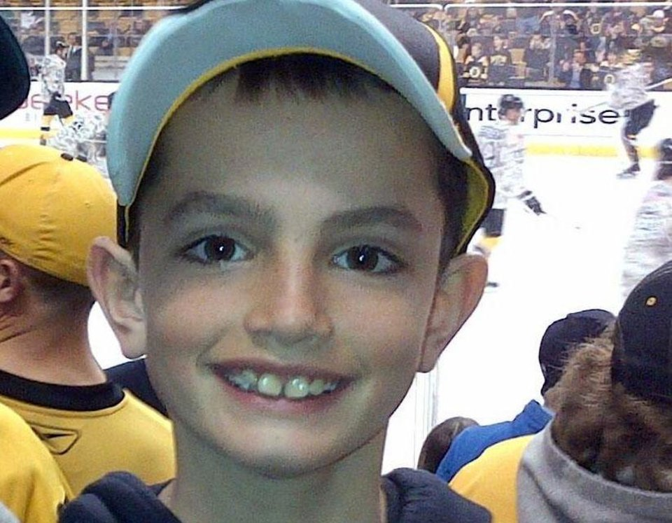 Photo - FILE - This undated photo provided by Bill Richard shows his son, Martin Richard, in Boston. Martin Richard, 8, was the youngest of three people killed in the explosions at the finish line of the Boston Marathon Monday, April 15, 2013.  A private funeral Mass, followed by burial, was held with immediate family attending Tuesday, April 23, 2013, for Martin Richard. No other details were provided.(AP Photo/Bill Richard)