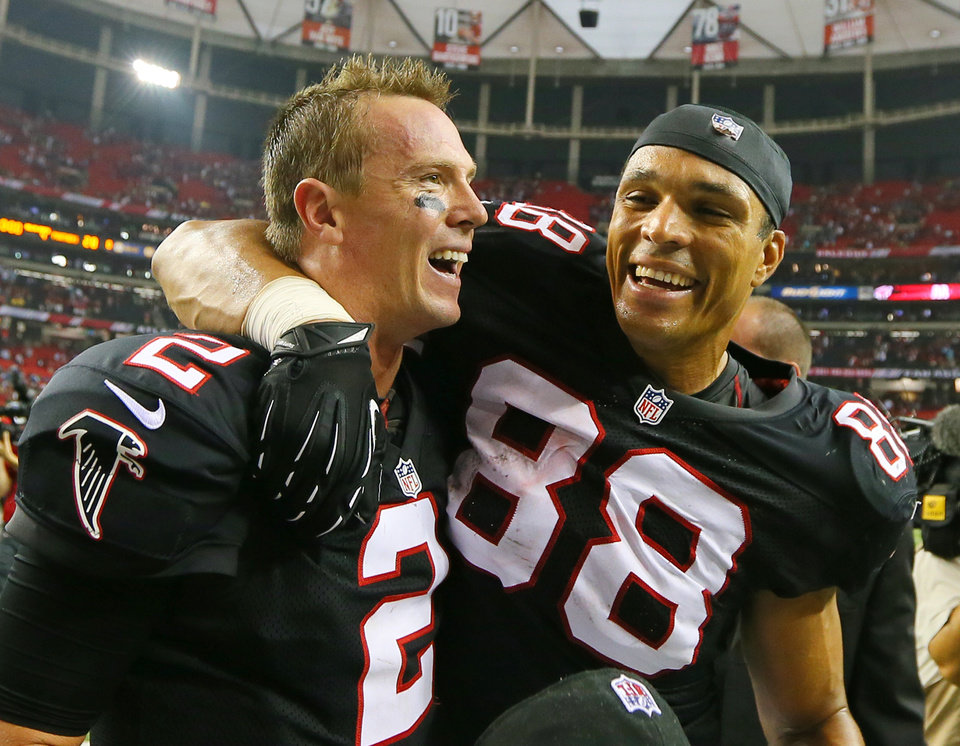 Falcons quarterback Matt Ryan,left, and tight end Tony Gonzalez celebrate a 30-28 victory over the Carolina Panthers in an NFL football game at the Georgia Dome in Atlanta on Sunday, Sept. 30, 2012. (AP Photo/Atlanta Journal & Constitution, Curtis Compton)